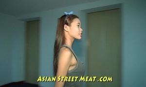 Little oriental girlette with bobbing boobies