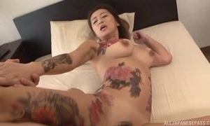 Tattooed Japanese MILF nearly chunky naturals receives drilled unchanging in triad