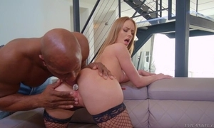 Pungent blonde widely applicable in fishnet stockings takes BBC in her nub