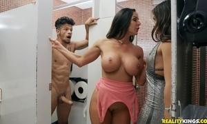 Bambino fucks two horny dark-haired hotties surrounding the powder-room