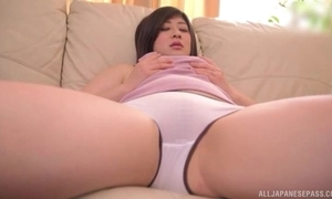 Juicy Asian little one roughly natural breasts masturbates on the couch